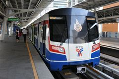 BTS Skytrain at a Station in Bangkok. A BTS Skytrain at a station in the city on March 18, 2012 in Bangkok, Thailand. Each train of the mass transport rail Royalty Free Stock Images