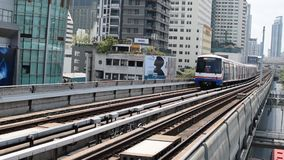 BTS skytrain train. Bangkok, Thailand - March 15, 2016 : BTS skytrain train runs in Bangkok. Many people in Bangkok used skytrain to save time stock video