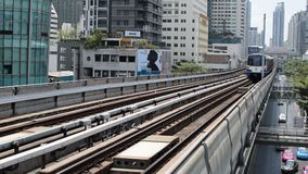 BTS skytrain train. Bangkok, Thailand - March 15, 2016 : BTS skytrain train runs in Bangkok. Many people in Bangkok used skytrain to save time stock footage