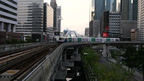 BTS train running near Chong Nonsi station early in the morning stock footage