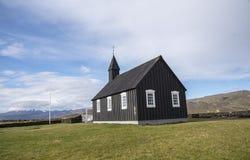 Buðir黑人教会, Snæfellsness半岛6的南部的边缘 免版税库存图片