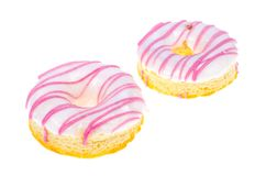 Buñuelo delicioso con el esmalte rosado blanco en fondo ligero fotos de archivo