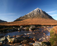 The buachaille. The peak of Buachaille Etive Mor above River Coupall Royalty Free Stock Photography