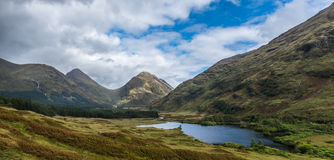 Buachaille Etive Mor and Buachaille Etive Beg from Glen Etive Stock Image