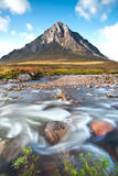 Buachaille Etive Mor in Glencoe,Scotland. Flowing water in the foreground mountain landscape Buachaille Etive Mor in Glencoe,Scotland Stock Photography