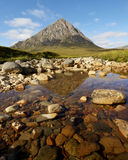 Buachaille Etive Mor mountain. Scenic view of Buachaille Etive Mor mountains with rocky lake in foreground, Glen Etive, Highlands, Scotland stock photos