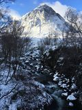 Buachaille Etive Mor in winter snow covered at Glencoe by Rannoch Moor West Highlands. Winter scene in Glencoe with vista of Buachaille Etive More near Rannoch Stock Photos