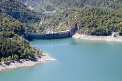 Bubal`s dam surrounded of pine trees and water in Pyrenees Royalty Free Stock Image