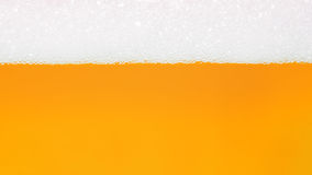 Bubbla av bakgrund för vatten för gul guld för öl Royaltyfria Bilder