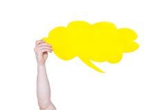 Bubbla för anförande för personinnehavguling tom med isolerat kopieringsutrymme Fotografering för Bildbyråer