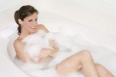 Bubble Bath. Beautiful Caucasian woman enjoying a nice bubble bath stock photo