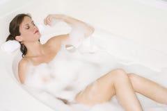 Bubble Bath. Beautiful Caucasian woman enjoying a nice bubble bath royalty free stock image