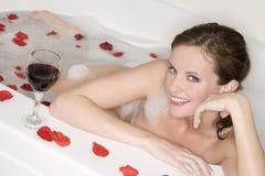 Bubble Bath. Beautiful Caucasian woman enjoying a nice bubble bath royalty free stock photography
