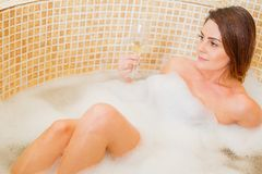 Bubble bath and champagne Royalty Free Stock Image