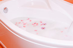 Bubble bath with flowers stock photo