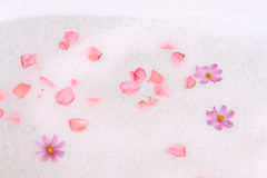 Bubble bath with flowers Stock Photos