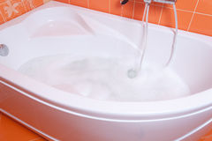 Bubble bath tub Stock Images