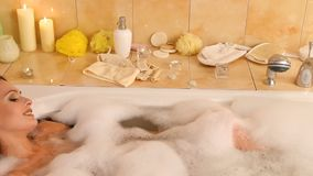 Bubble bath for woman taking , blow on foam . Dolly system. stock video