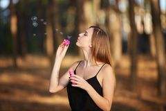 Portrait of pretty woman with bubbles, traveler relaxing in forest. Stock Image