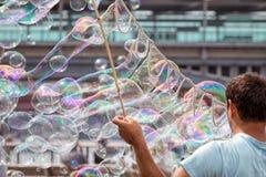 Bubble Blowing Street Entertainer. A Bubble Blowing Street Entertainer Performs Royalty Free Stock Photos