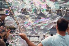 Bubble Blowing Street Entertainer. A Bubble Blowing Street Entertainer Performs Stock Photos