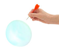 Bubble burst by woman's hand with dart royalty free stock photography