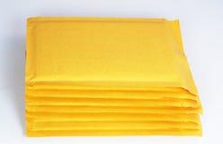 Bubble envelopes. Stack of yellow bubble envelopes Stock Photo