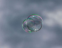 Bubble floating in the sky. Outside during the daytime royalty free stock photography