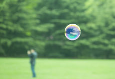 Bubble flying over grass land Royalty Free Stock Image