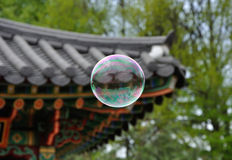 Bubble in front of roof of oriental arbor Royalty Free Stock Photography