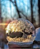 The bubble froze in the cold. Soap bubble froze in the cold on a sunset background stock photography