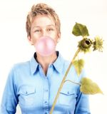 Bubble Girl. A girl blowing a big bubble Stock Photo
