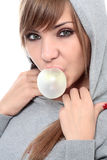 Bubble gum. Close-up portrait of young beautiful woman with bubble gum isolated on white Royalty Free Stock Photo