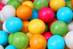Bubble gum chewing gum texture. Rainbow multicolored gumballs chewing gums as background. Round sugar coated candy. Dragee bubblegum texture. Food photography royalty free stock photo