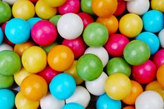 Bubble gum chewing gum texture. Rainbow multicolored gumballs chewing gums as background. Round sugar coated candy Royalty Free Stock Photography