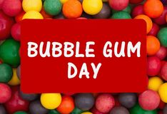 Bubble Gum Day message with colorful gum. Bubble Gum Day message, Colorful multi colored bubble gum background with text Bubble Gum Day royalty free stock images