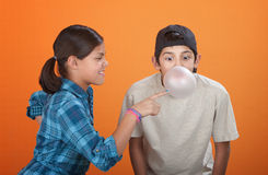 Bubble Gum Pop. Girl touching a bubble blown by her brother with chewing gum Stock Image
