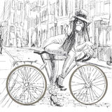 Bubble gum. Topic: chewing gum. Girl resting on a bicycle and blowing bubbles Stock Images