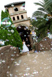 Bubble Love. A wedding couple ouside chapel with confetti Stock Images