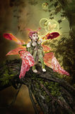 Bubble Magic. 3D computer graphics of a fairy sitting on a tree trunk and blows bubbles and butterflies Stock Images