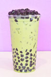 Bubble milk green tea. In plastic cup stock photography