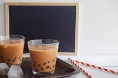 Bubble milk tea. Iced bubble milk tea with blackboard for note royalty free stock photo