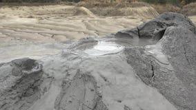 Bubble mud volcanoes, natural phenomenon stock footage