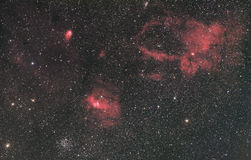 Bubble Nebula Surroundings. The Buble Nebula is a emission nebula in the constellation Cassiopeia. The nearby M52 open cluster and other nebulae mak this a very stock photo