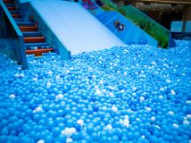 Bubble pool for kids with toys. Blue bubble pool for kids, child and children. play inside like swiming in the sea for fun. execise to improve the baby action. a Stock Photography