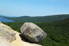 Bubble Rock on top of the South Bubble Mountain and Jordan Pond at Acadia National Park in Maine Stock Image