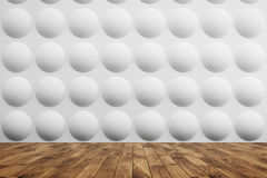 Bubble room with light wood floor. Empty room interior with white walls with a bubble pattern on them and a light wooden floor. Concept of a comfortable and a Stock Images