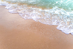 Bubble of Sea wave on sand Stock Image