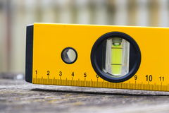 Bubble spirit water level construction tool on wooden board closeup Royalty Free Stock Image