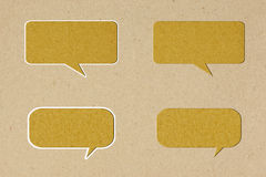 Bubble talk  tag on brown  paper. Background Royalty Free Stock Images